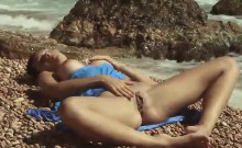 Nadina L spreads legs and masturbates by the sea