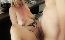 Saggy tit blonde sits on a kitchen chair while he pounds her twat