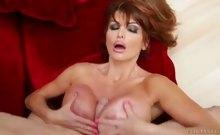Milf displays her huge tits on cam before pleasing big cock.