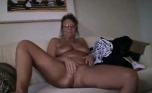 Puffy blonde milf shows her large breasts and moist vagina
