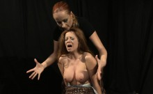 Busty ginger punished in bondage action