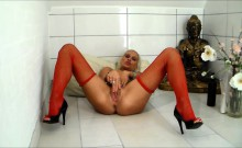 Mature busty blonde playing with a cock