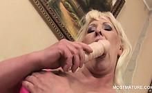 Lonely blonde mature using her favorite dildo to masturbate