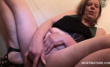 Mature blonde hooker fucking herself deep with two fingers