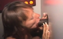 Mature Brunette Sucking Strangers Dicks Through Glory Hole