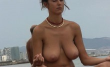 Stacked brunette cougar gets naked and takes a yoga class on the beach