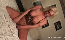 Blonde mature in big tits masturbating cunt with toys and