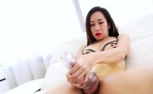 Busty Asian Tranny Tanny Jerks Off Her Massive Cock With Toy