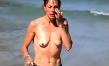 Girl Topless On Beach With Small Empty Saggy Tits